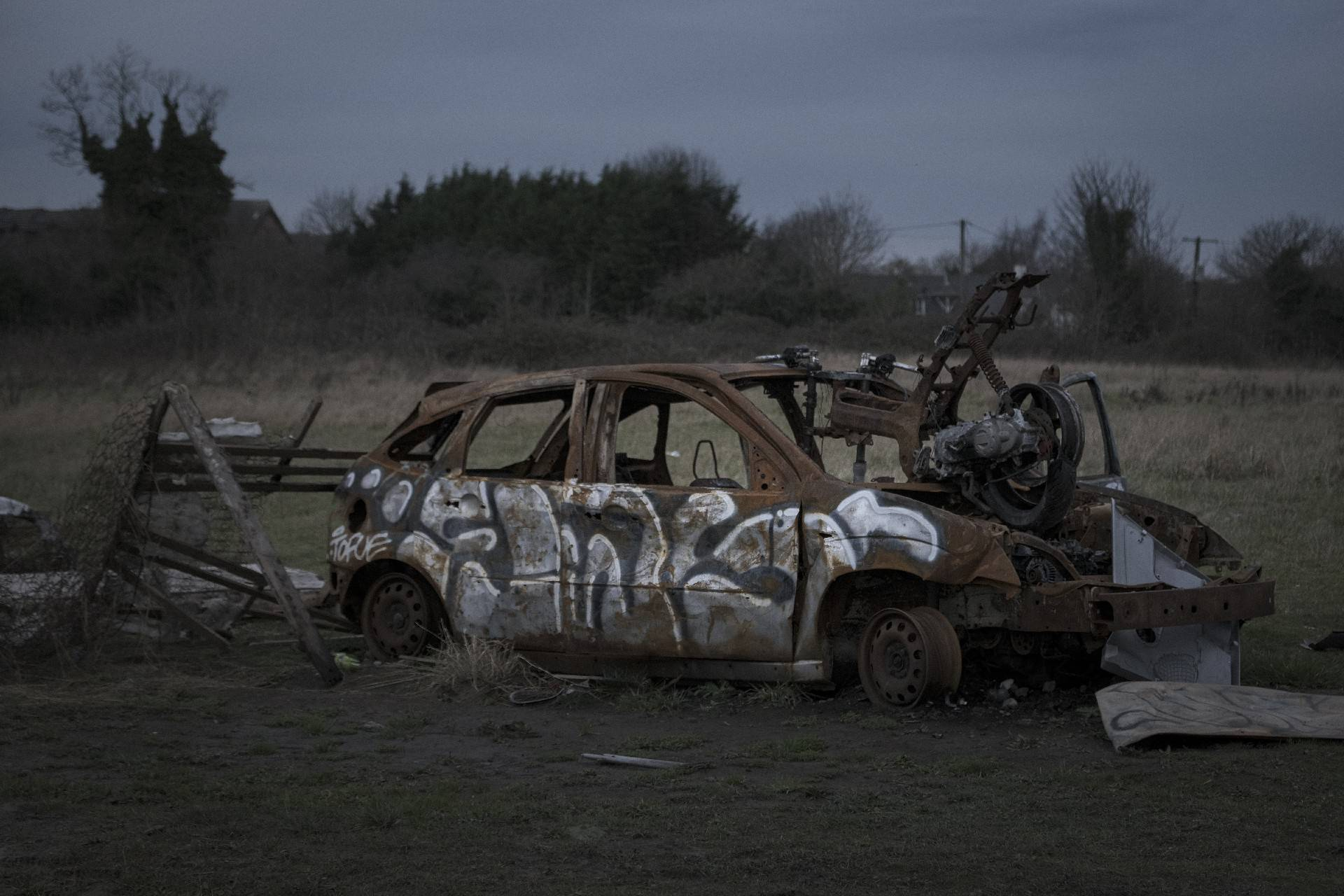 Abandoned car on a field